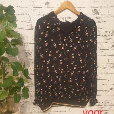 blouse met bloem